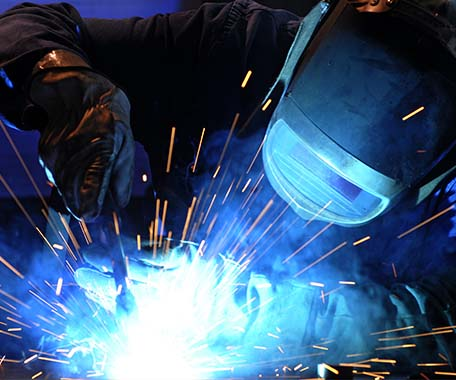 technicians welding as sparks fly